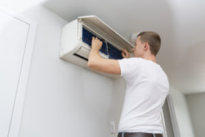 Maintenance Worker Changing the Filters in an Air Conditioning Unit