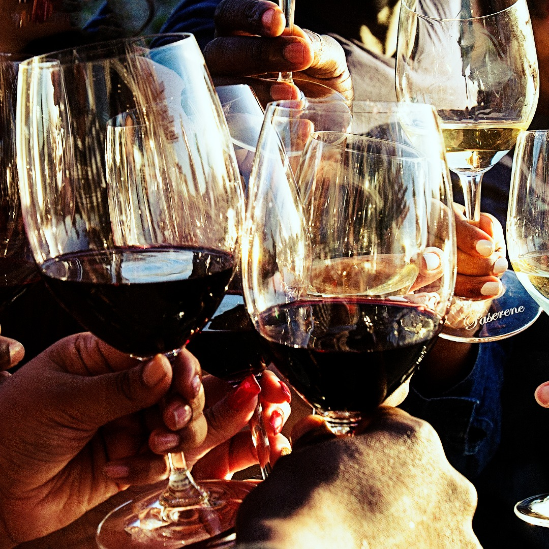 Toasting with Red and White Wine