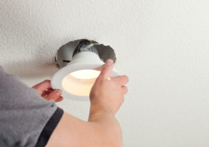 Timbergrove Property Manager Installing an Energy Efficient Light Fixture