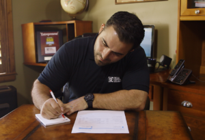 Houston Heights Property Manager Making Notes About Security Deposits for Former Tenants