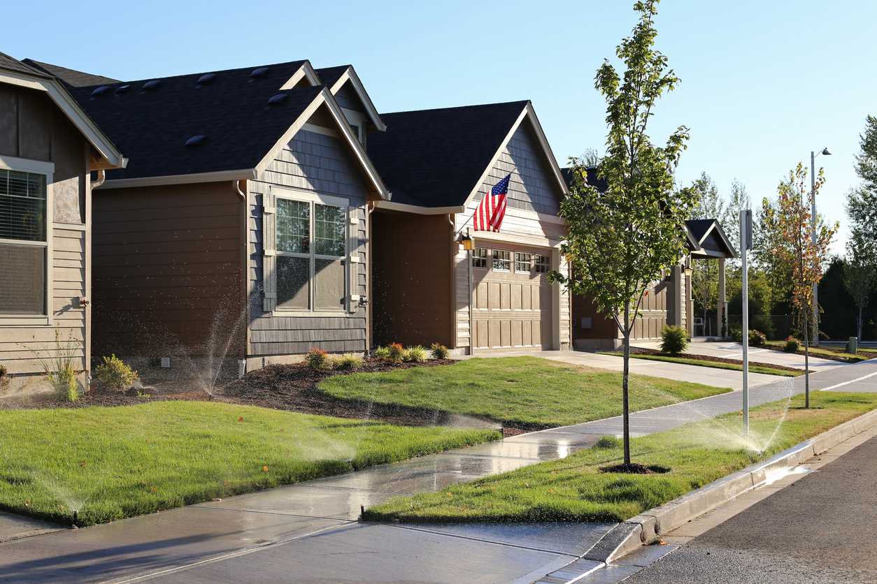 Greeley Rental Property Watering Their Lawn with Sprinkler System