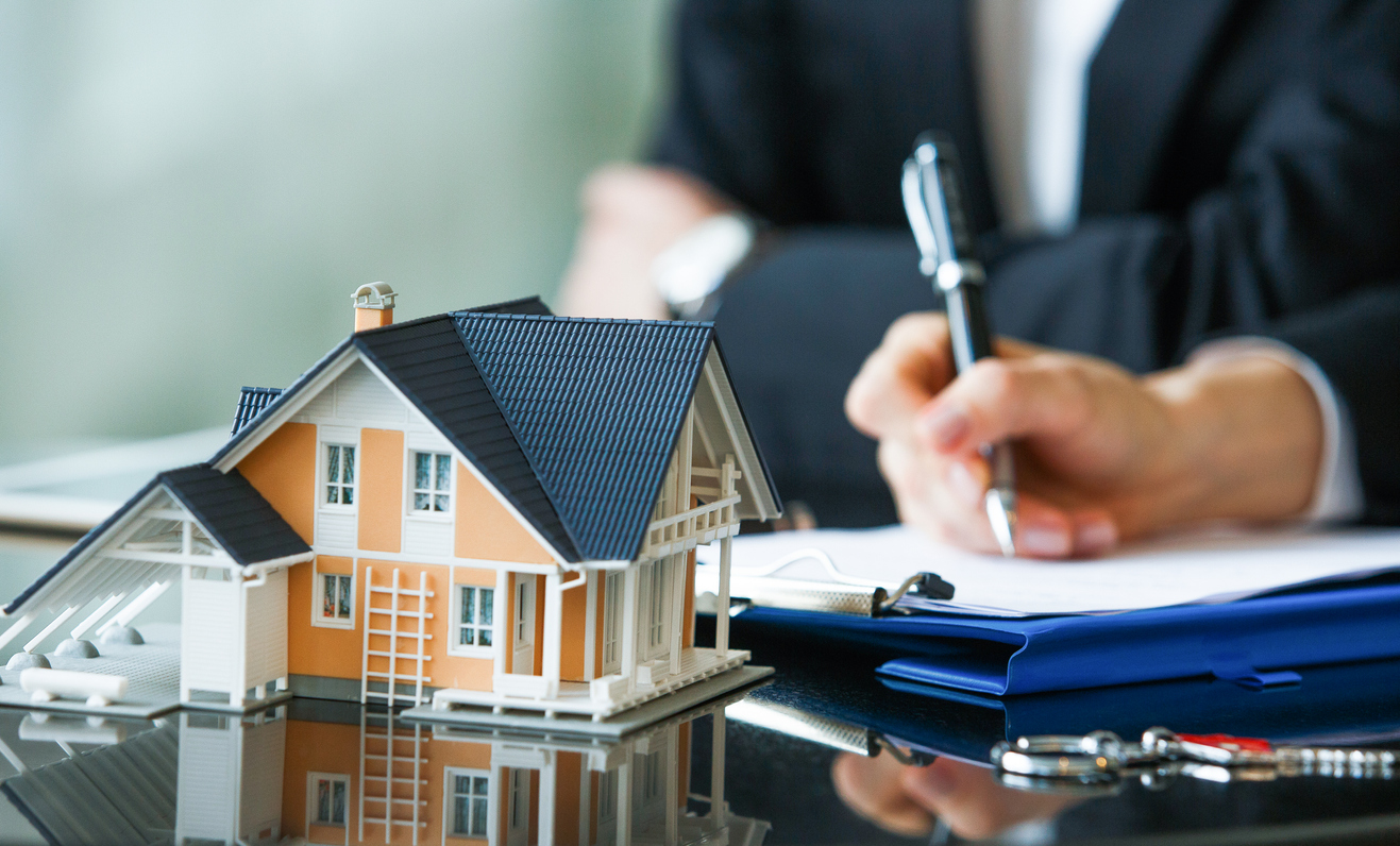 Signing Papers After the Purchase of an Investment Property in Longmont