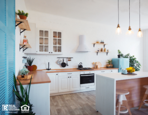 Modern, Newly Remodeled Kitchen with Painted Cabinets and New Light Fixtures