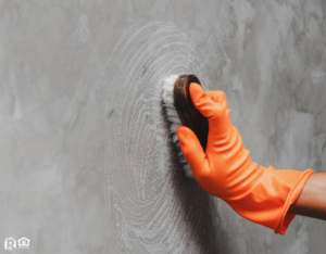 Scrubbing a Wall in a Gallatin County Rental Property