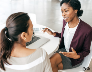 Two Business Women Making an Investment Decision