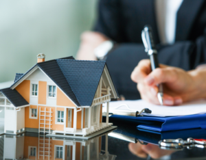 Signing Papers After the Purchase of an Investment Property in Alexandria VA