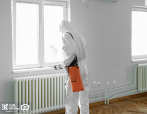 Man in Chemical Protection Suit and Face Mask Spraying for Bugs in a House