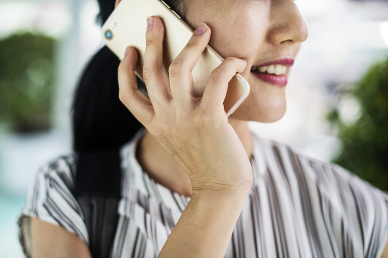 Woman calling on mobile device