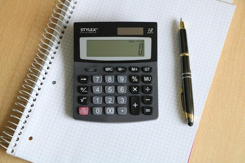 Calculator and Pen on Desk