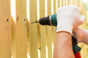 Augusta Professional Installing a Fence