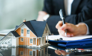 Signing Papers After the Purchase of an Investment Property in Richardson