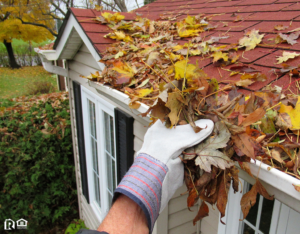 Bar Harbor Rain Gutter Full of Leaves Being Cleaned Out