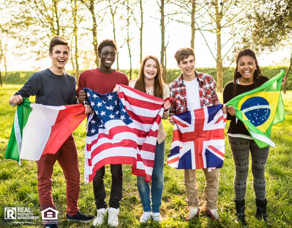 International Students Holding the Flags of their Respective Countries