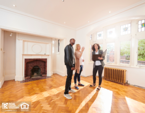 Corinth Real Estate Agent Showing Property Investors a Refurbished Home