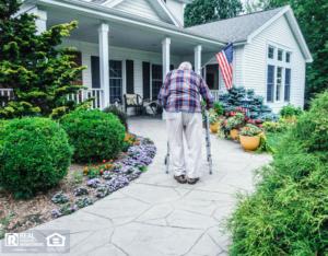 Elderly Lewisville Man Walking Up the Path to the Front Door