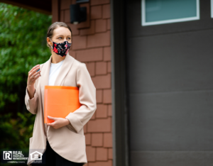 Property Investor Standing in Front of Property with Face Mask