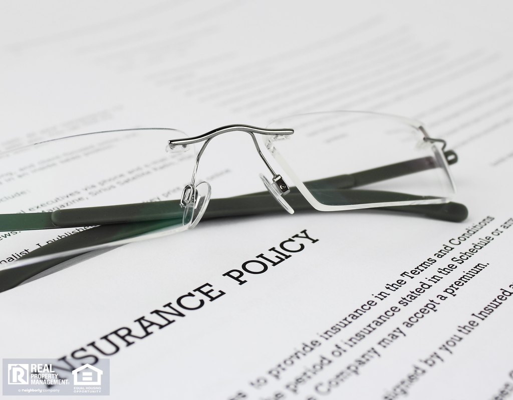 Maitland Renter's Insurance Policy with Glasses Propped on Top