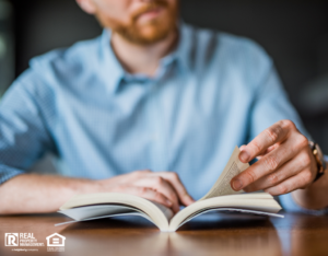 Maryland Heights Real Estate Investor Reading an Informative Book