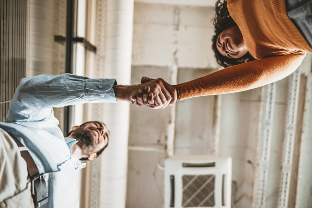 Two Business people shaking hands after Welcoming partners finishing up a meeting