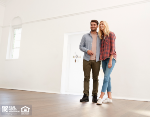 Couple Taking Self-Guided Property Tour in Huntington Woods
