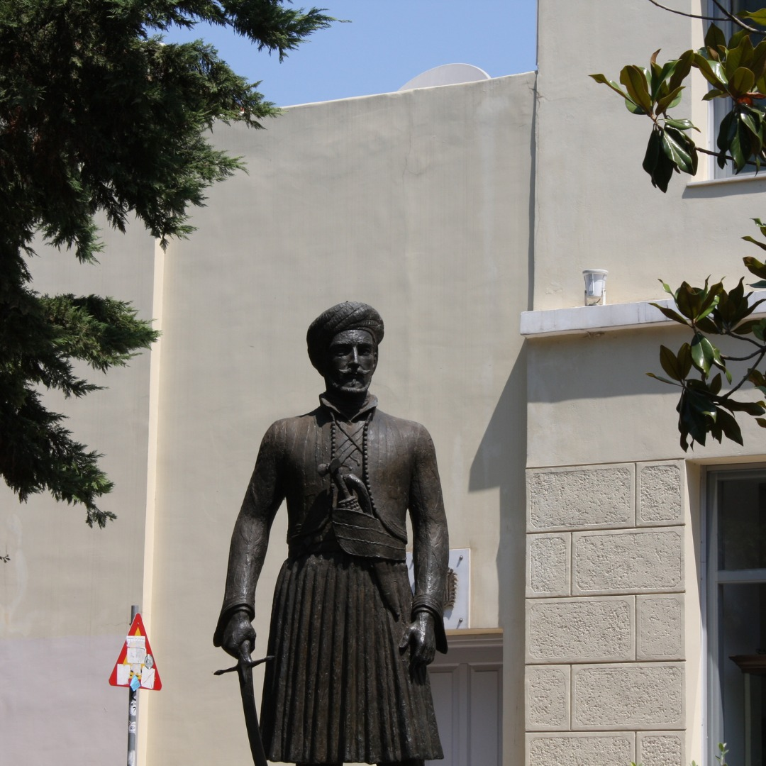 statue of female in front of building
