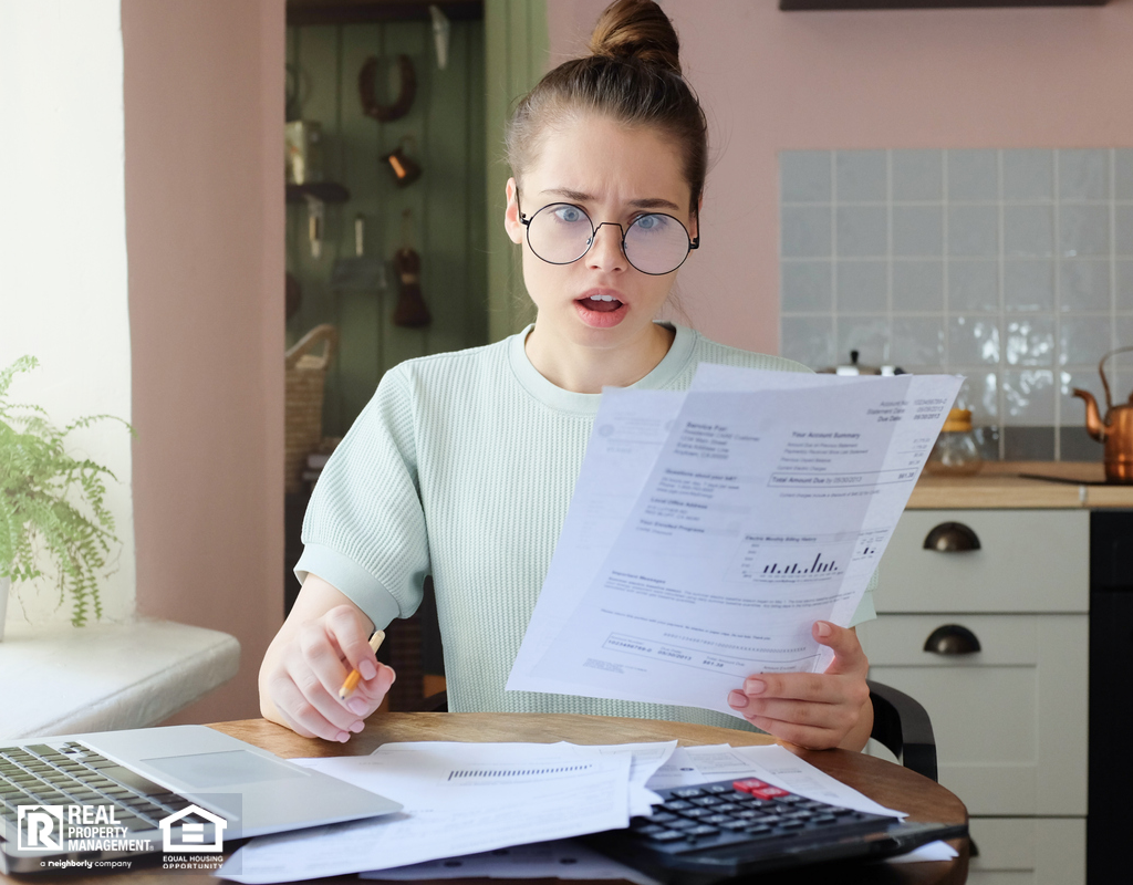 Shocked Woman Looking At Electricity Bill