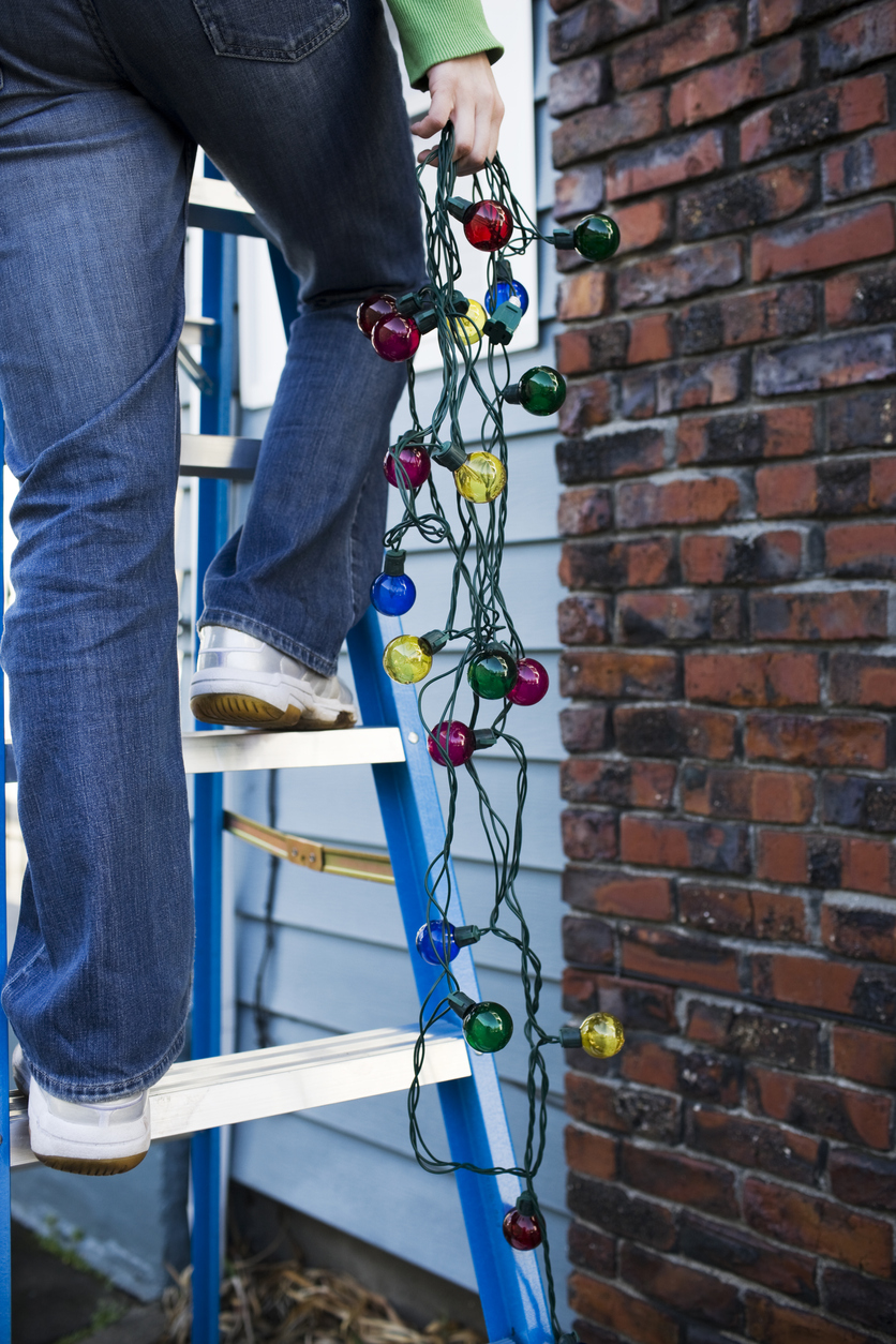 Woodstock Tenant Hanging Christmas Lights for the Holiday Season