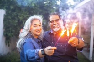 Woodstock Couple Holding Sparklers Together