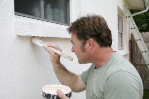 Man Painting the Exterior of a Marina Del Rey Rental Property