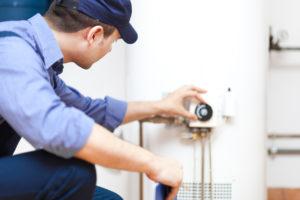 Man Fixing a Water Heater in Mar Vista Rental Property
