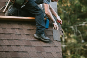 General Contractor Installing New Roof on Greenfield Rental
