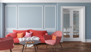 Coral Chairs in Front of a Powder Blue Wall