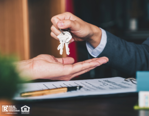 Agent Handing Property Investor Keys After Purchase