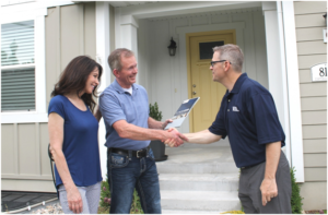 Real Property Management Metro Detroit employee shaking hands with tenants