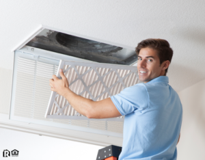 Maintenance Man Installing a Fresh Air Filter in the HVAC System