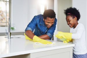Redford Family Cleaning the Kitchen