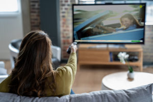 Deerfield Beach Tenant Relaxing at Home Watching Cable TV