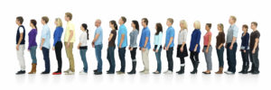Full length portrait of men and women standing together in a line against white background