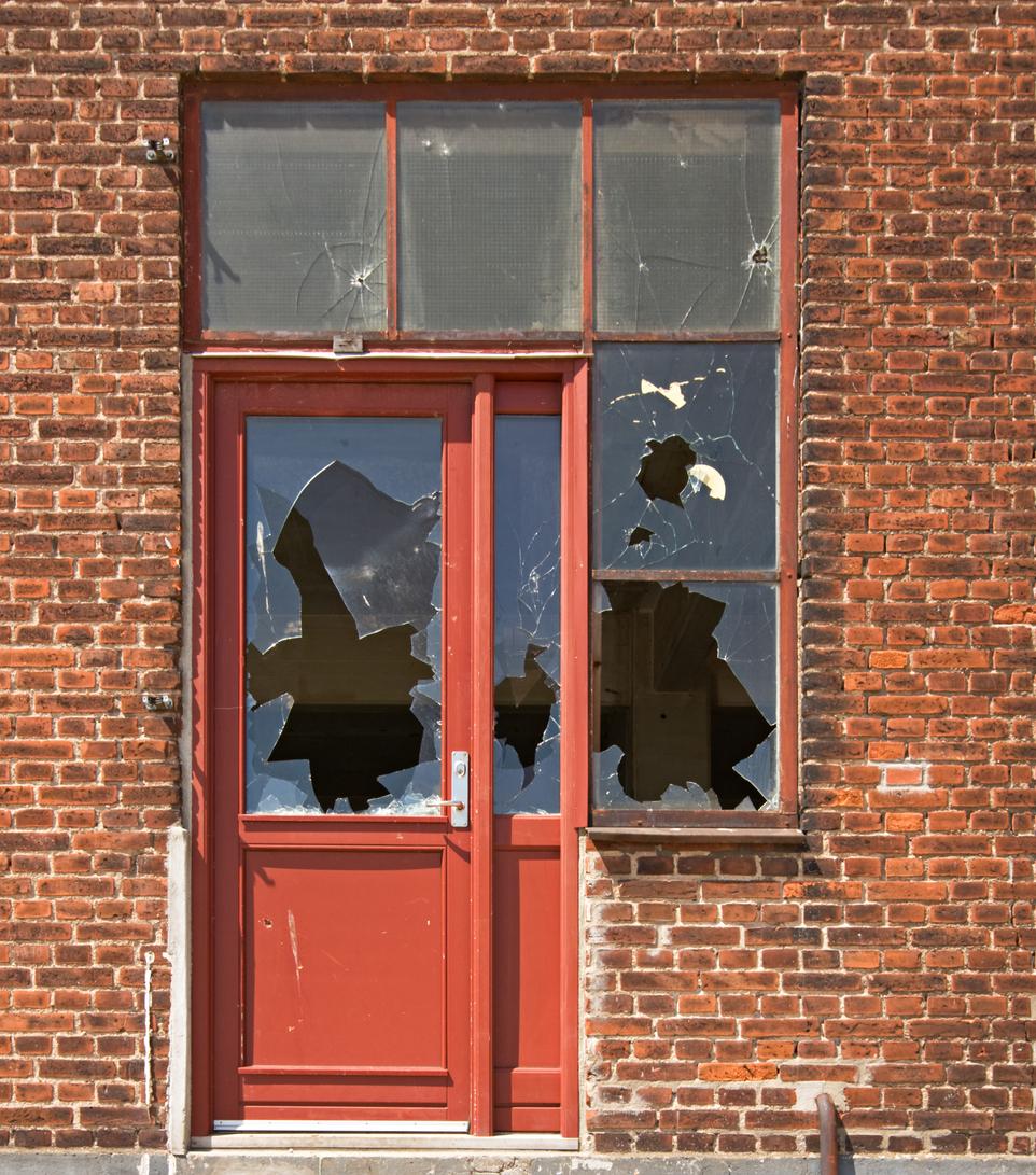 Hurricane Rental Property with a Broken-In Door and Windows