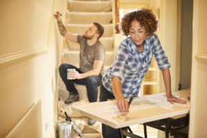 Woman and Man Re-Painting Dallas Home Interior