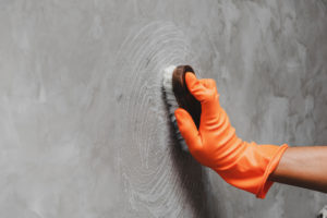 Scrubbing a Wall in a Jamaica Plain Rental Property