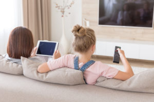 Mother and Daughter Watching Cable TV in Their Quincy Rental Home