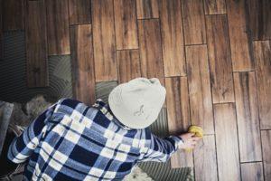 Man Installing Brookline Flooring