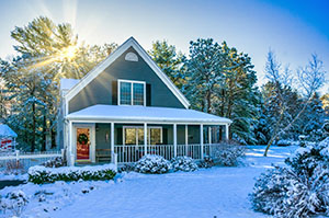 Cozy Home Covered in Snow on Sunny Winter Day