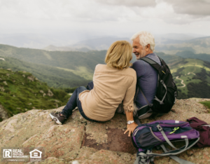 Older Couple Resting During Hike with Backpacks