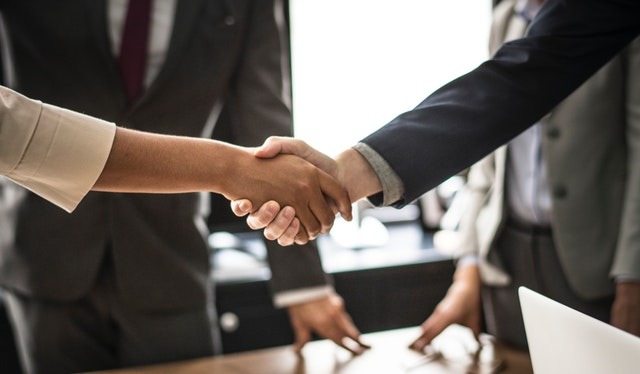 Two People Shaking Hands After a Successful Business Meeting