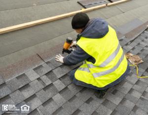 Handyman working on roofing repairs