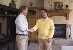 Raleigh Resident and Landlord Happily Shaking Hands