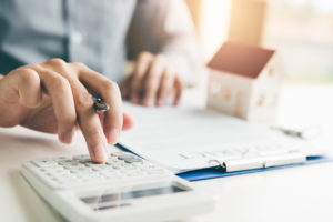 Pineville Real Estate Investor Crunching Numbers to Determine his ROI