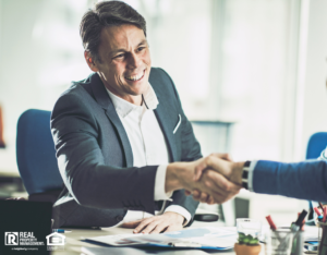 Matthews Investor Shaking Hands with a Business Partner